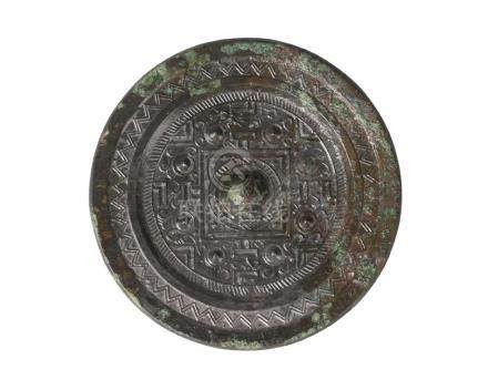 A Chinese bronze 'TVL' mirror, Han dynasty, centred with a raised knob surrounded by eight studs and