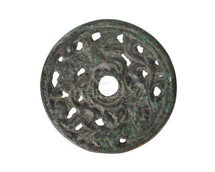 A Chinese bronze Han-style circular plaque, late Qing dynasty, pierced with animals and floral