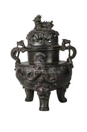 A large Chinese bronze tripod censer and cover, Ming dynasty, 16th century, the body cast with a