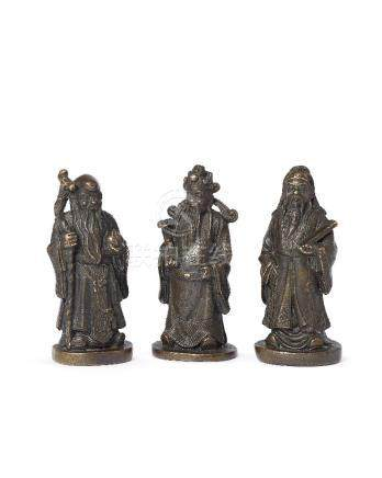 Three Chinese bronze scroll weights depicting The Three Star Gods, late Qing dynasty, depicting