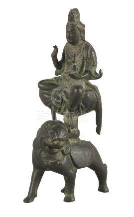 A Chinese bronze figure of Samantrabhadra on a lion, Song dynasty style, seated in lalitasana, the