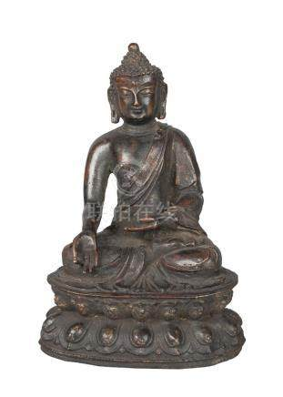 A Chinese bronze figure of Shakyamuni Buddha, Ming dynasty, 17th century, seated in dhayasana, on