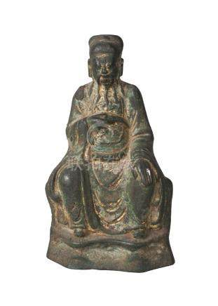 A Chinese parcel gilt bronze figure of an official, Ming dynasty, 16th/17th century, seated with