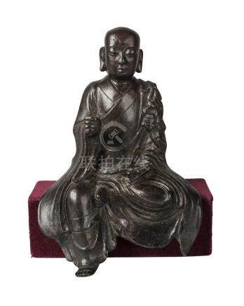 A Chinese bronze seated Lohan, Ming dynasty, 16th/17th century, seated at 'Royal Ease', with
