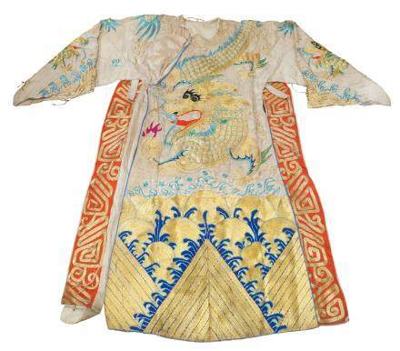 A Chinese silk embroidered dragon robe, early 20th century, embroidered to front and back with a