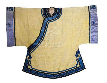 A Chinese yellow kesi silk floral jacket, early 20th century, with blue silk embroidered floral