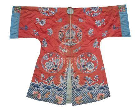 A Chinese silk embroidered robe, 19th century, decorated with roundels of flowering chrysanthemum on