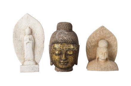 Three Chinese/South East Asian stone carvings, 20th century, comprising a gilded head of Buddha,
