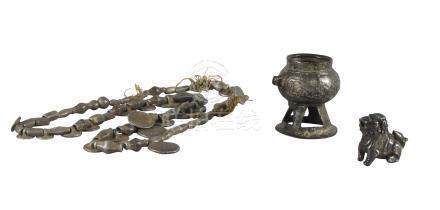 A silvered metal miniature censer, 19th century, a silver model of a Buddhist lion, and a silvered