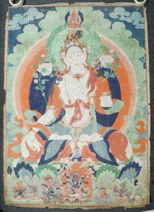 A large Tibetan thangka of Tara, 19th century, distemper on cloth, seated in dhayasana, with two