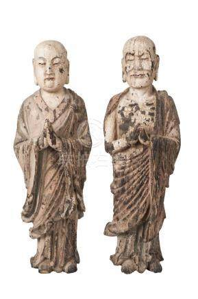 A pair of Chinese carved wood and painted gesso Lohan, 18th/19th century, both carved standing, with