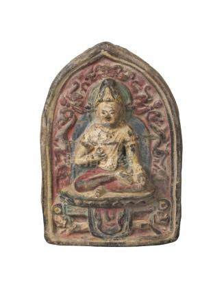 A Tibetan painted terracotta votive plaque, mid-19th century, of arched form, depicting Maitreya,