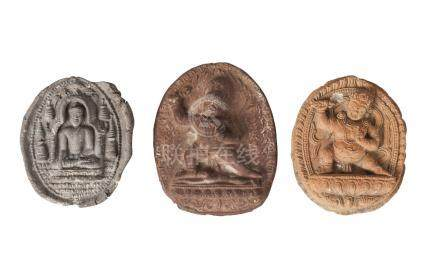 Three Tibetan terracotta votive plaques, 18th/19th century, one depicting Buddha seated,