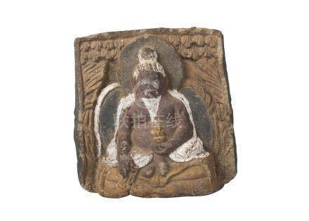 A Tibetan painted terracotta votive figure, 18th/19th century, depicting Lama seated, 13cm x 11cm