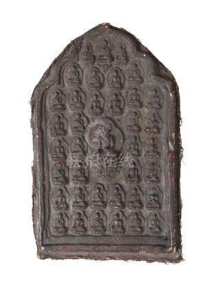 A large Tibetan terracotta votive plaque, 18th/19th century, depicting Shakyamuni Buddha, surrounded