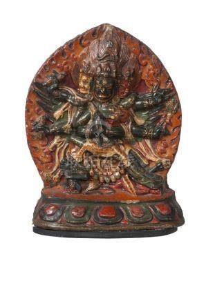 A large Tibetan painted terracotta votive plaque, 18th century, depicting Vajrakila with a flaming