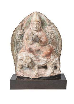 A rare Tibetan painted terracotta votive figure, 17th century, depicting lama on an elephant, with