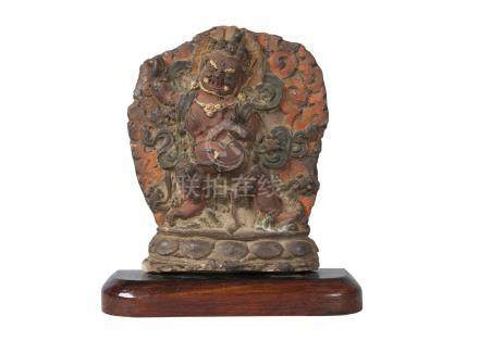 A Tibetan painted terracotta votive plaque, 17th century, depicting Havagriva, 20cm high