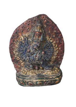 A Tibetan painted terracotta votive figure, 18th century, deppicting Yamantaka, 15cm high