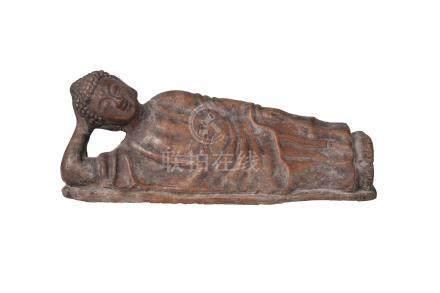 A Chinese terracotta figure of Shakyamuni Buddha, 19th century, modelled reclining with head