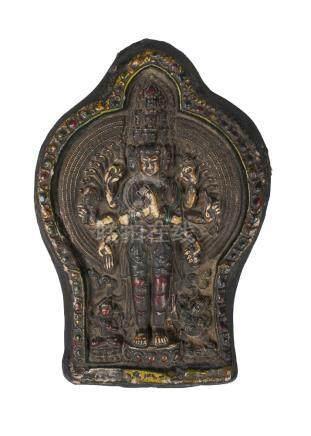 A Tibetan painted terracotta votive plaque, 19th century, depicting Ekadashalokeshvara, 25 x 17cm