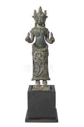 A Khmer Bayon style bronze figure, 13th century, depicting Prajnaparamita standing, wearing