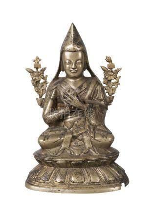 A Sino-Tibetan bronze figure of Tsongkhapa, 19th century, seated in Dhayasana, with detachable