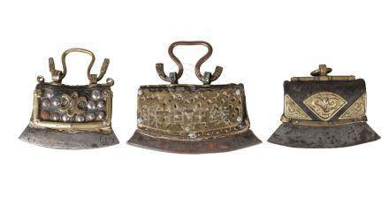 Three Tibetan brass and studded leather tinder pouches, 19th century, one with embossed brass mounts