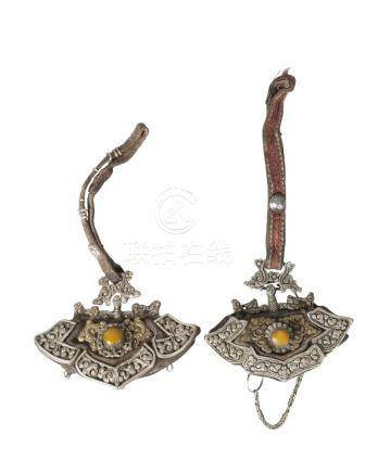 Two Tibetan gilt and white metal mounted leather tinder pouches, 19th century, each decorated with