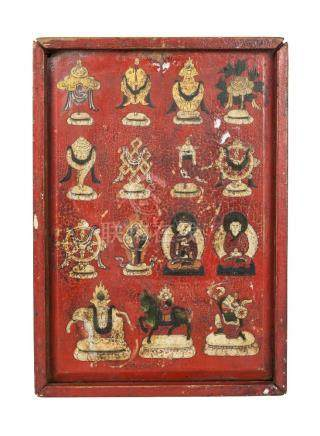 A Tibetan painted wood box, 19th century, housing a painted terracotta plaques depicting various