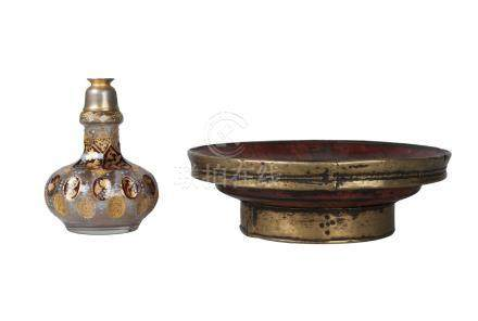 A Tibetan brass mounted wooden bowl and a Bohemian flash cut flask, 19th century, the flask