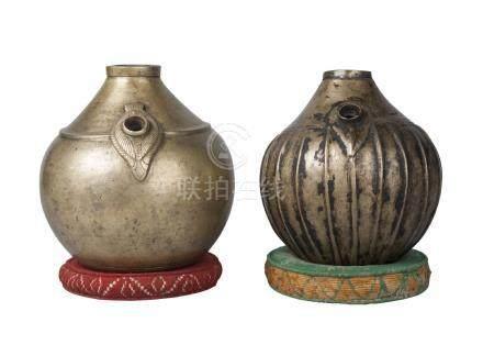Two Tibetan bronze globular hookah bases, 19th century, one lobed, both on woven ring pads, 18cm