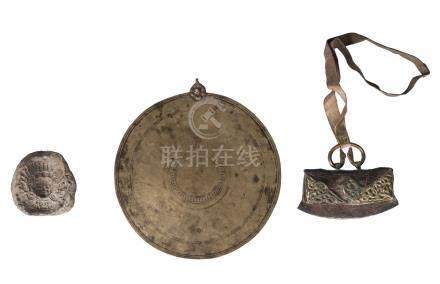 A Tibetan bronze ceremonial disc, 19th century, 21cm diameter, a Tibetan gilt bronze mounted and