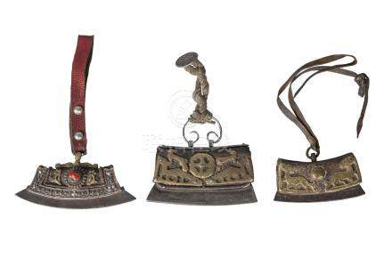 Three Tibetan tinder pouches, 19th century, two with brass mounts pierced as animals, 10.5cm and