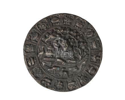 A Chinese silvered bronze circular plaque, 19th century, centred with Shoulao seated beneath