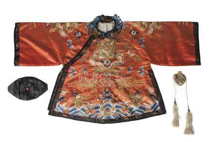 A Chinese silk embroidered 'dragon' jacket, 19th century, decorated with a confronting dragon amidst