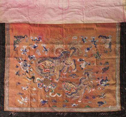 A Chinese silk embroidered altar front, 19th century, decorated with a pair of Buddhist lions on a