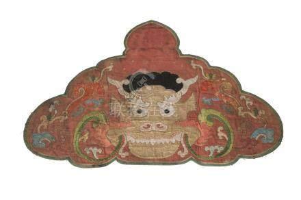 A Sino-Tibetan cloud collar, 18th/19th century, embroidered with a dragon's head, 46cm x 63cm