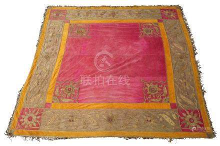 A large Turkish table cover, c.1900, decorated with couched gold thread on a crimson ground, 230cm x