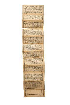 A Tibetan manuscript, early 20th century, inscribed with Buddhist mantra, wrapped in a red cloth,