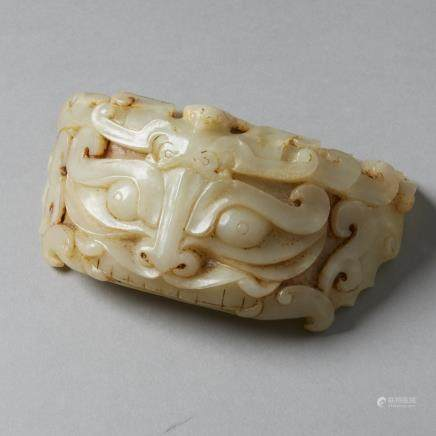 Chinese carved pale Jade Dragon or Taotie Mask Fitting