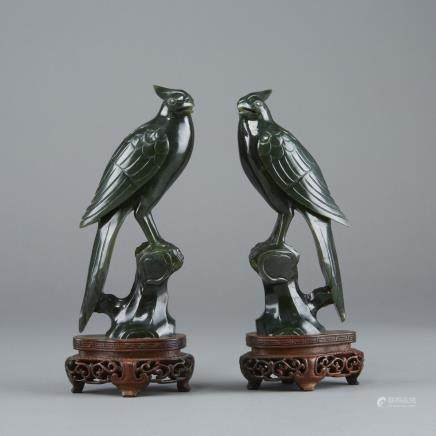 Pair of Chinese Late Qing or Republic period dark green Jade Birds on Original Stands