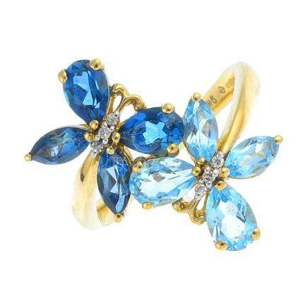 A 9ct gold topaz and diamond ring. Designed as two pear and marquise-shape blue topaz butterflies,