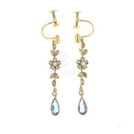 A pair of early 20th century gold aquamarine and split pearl earrings. Each designed as a pear-shape
