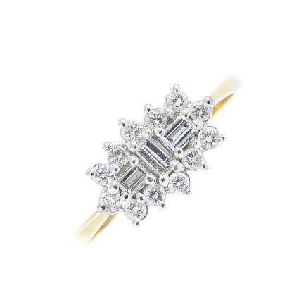 An 18ct gold diamond cluster ring. The baguette-cut diamond line, with brilliant-cut diamond
