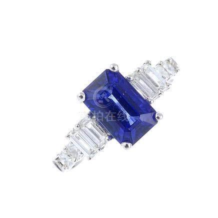 A sapphire and diamond dress ring. The rectangular-shape sapphire, with baguette-cut diamond line