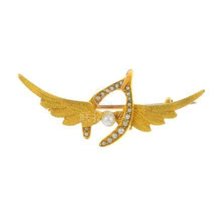 An early 20th century gold seed and split pearl brooch. Designed as textured wings, with split pearl