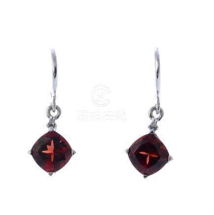 A pair of garnet and diamond earrings. Each designed as a cushion-shape garnet and single-cut