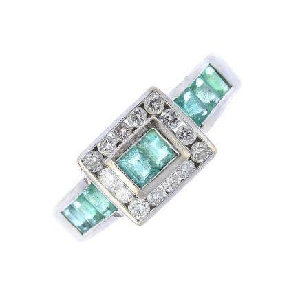 An 18ct gold emerald and diamond cluster ring. The rectangular-shape emerald duo, within a