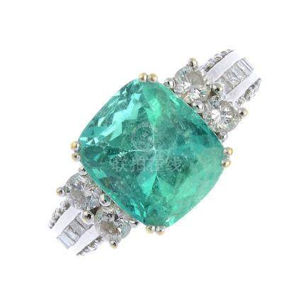 An emerald and diamond dress ring. The cushion-shape emerald, with brilliant-cut diamond sides and